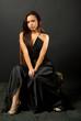 The girl in the dress in the studio
