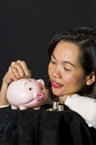 young woman with pink piggy bank