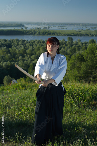 Young woman are training in Aikido in wood