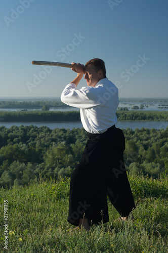 Young man are training in Aikido on the wood