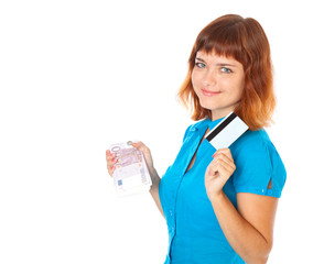 The red-haired young girl with a credit card and a bundle of ban