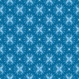 White snowflakes on blue seamless background