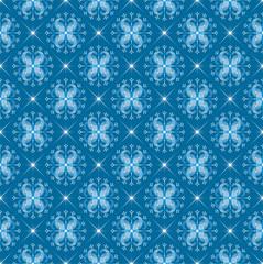 White snowflakes on blue seamless background