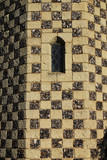 Chequered stone Tudor tower detail with lattice window