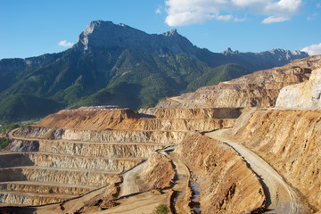 Erzberg iron mine with mountains.