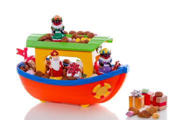 Dutch festive with Sinterklaas and Piet on the boat isolated on