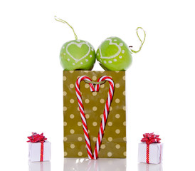 apple christmas balls with candy cane hearts and gifts on a shop