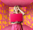 blonde in pink dress with laptop