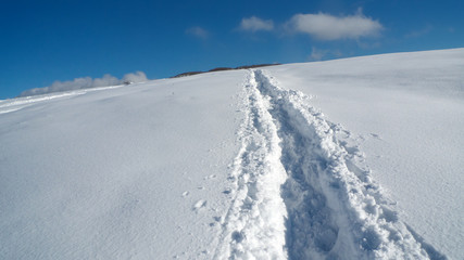 Path in snow leading to the top