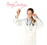 doctor woman writting Merry Christmas