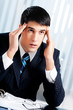 Thinking, tired or ill with headache businessman at office