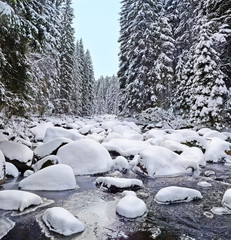 mountain river with big stones in winter