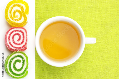 Colorful candy and tea