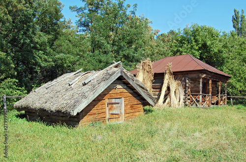 Ancient traditional ukrainian rural barn with a straw roof