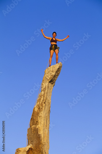 Rock climber reaching the summit.