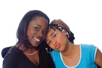 African american mother and daughter smiling