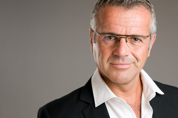 Satisfied mature man with glasses