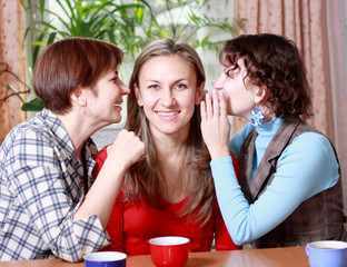 Two women share secrets with a friend