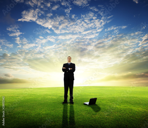 young businessman and sunset