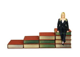 Woman sitting on books