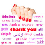 "Hand holding card with the word ""thank you"" in many languages"