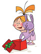 Girl in pajamas opens a Christmas gift with funny bunny