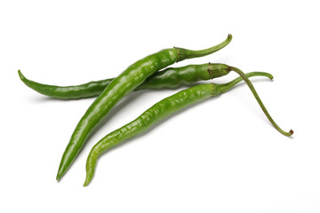 three green chillies isolated on the white background