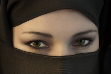 The woman in a black Muslim scarf