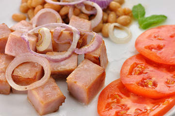 ham with beans and tomatoes close up