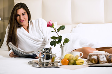 Relaxed Woman Having Breakfast in Bed