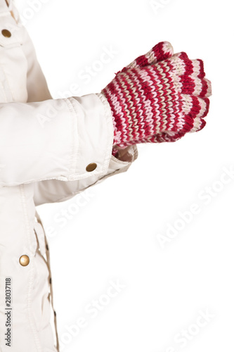 Woman hand in colorful and warm gloves isolated on white