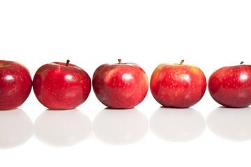 Fresh red juicy natural apples on white isolated background