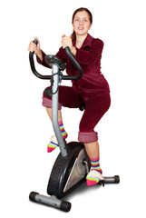 Young woman working out on exercycle