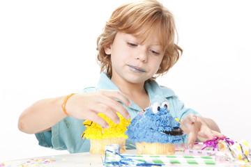 Young kid enjoys a creative cupcake