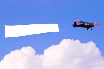 Airplane flying blank banner