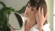 Woman looking herself in the mirror; HD 720, H 264