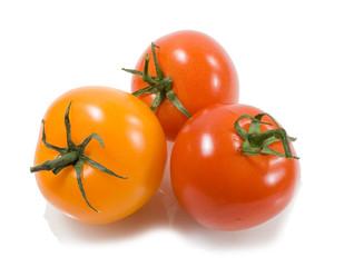 red ana orange tomatoes with drops of water isolated on the whit