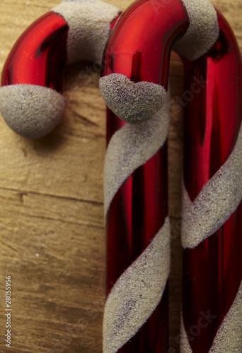 2 Candy Cane laying on a gold table