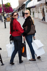 Happy smiling women shopping with white bags