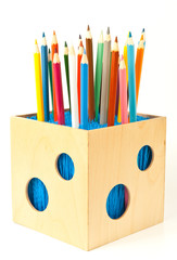Pencil box with color pencils over white