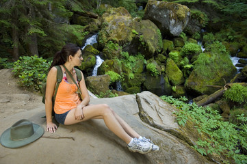 Young woman hiking in summer