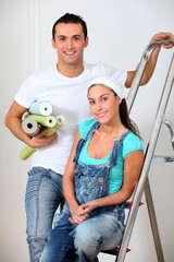 Young couple choosing color of wallpaper