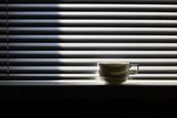 Coffee mug on a window sill poster