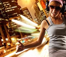 Stylish dancing girl against night city