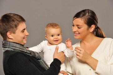 Happy family isolated on grey background