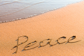 Word Peace on sand