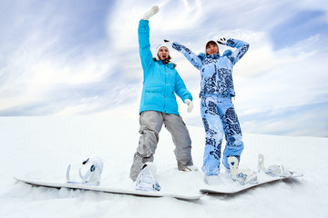 Two snowboard rider girls
