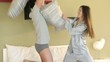Young couple doing pillow fight in bedroom;  HD 720, H 264