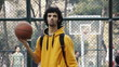 Young man play basketball ball turn on finger streetball