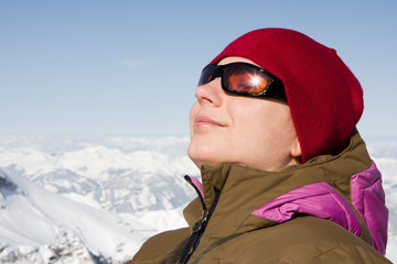 Woman enjoying sun in winter day